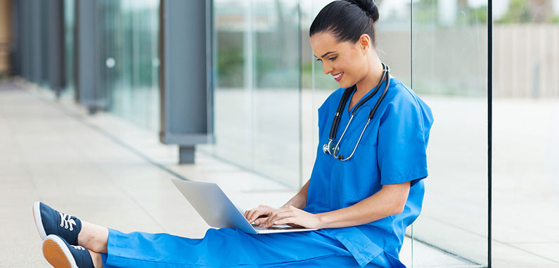 graduate nursing degree student on laptop